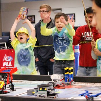 2015 FIRST LEGO League Team Celebrating During a Robot Game Match